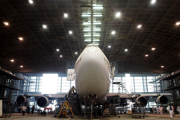jumbo jet in maintenance hangar
