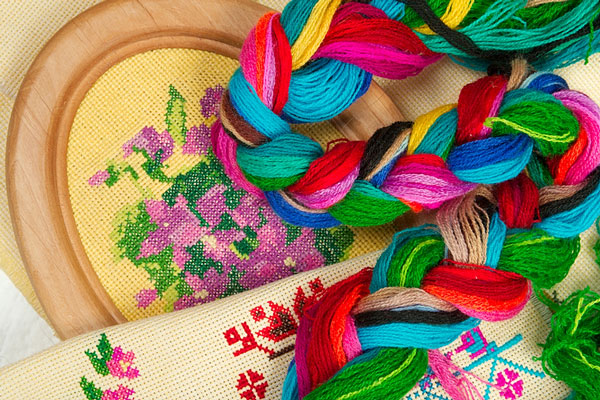 colorful yarn and needlepoint