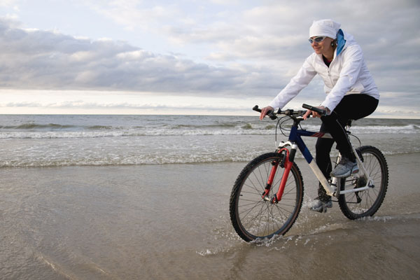 bicycle riding along the beach