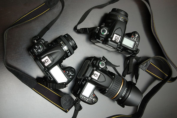 three dslr cameras - digital cameras