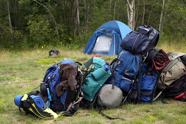 camping tent, sleeping bags, and backpacks