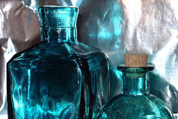 vintage blue glass bottles and cork