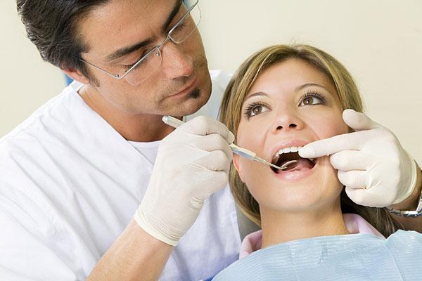 dentist using dental mirror