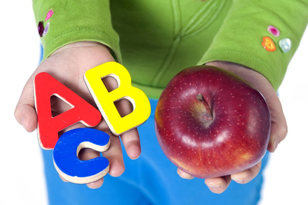 Education picture - student with red apple and abc letters