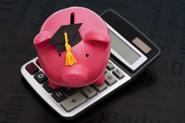 mortar board, piggy bank, and calculator