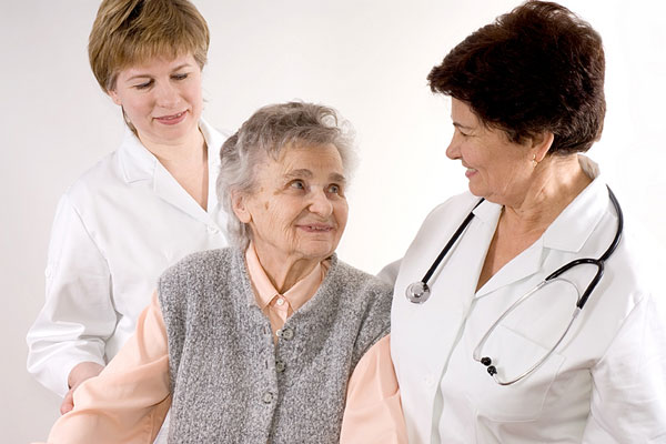 health care professionals with elderly patient