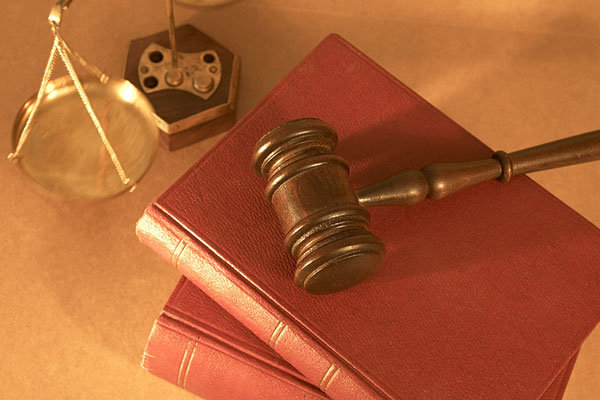courtroom gavel, law books, and scales of justice
