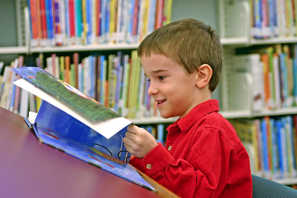 child reading a library book