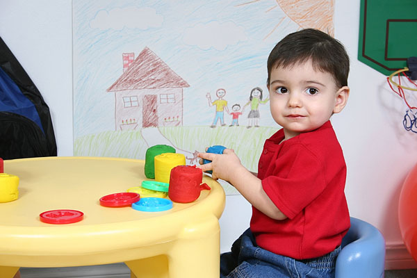 preschooler playing at table