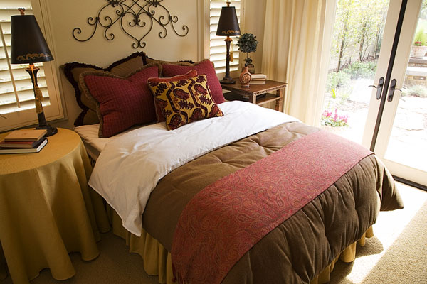 bedspread, pillows, and bed linens